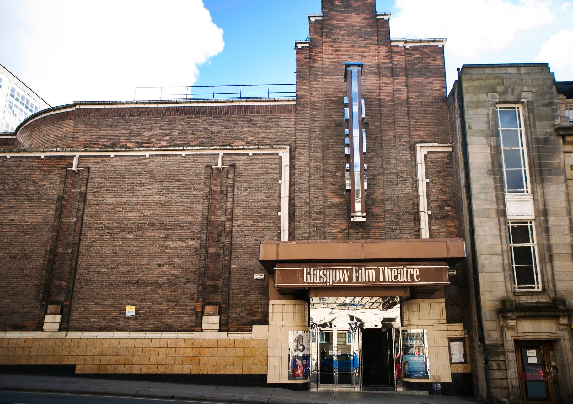 The brown stone exterior of the Glasgow Film Theatre, a 1930s art deco building in Glasgow